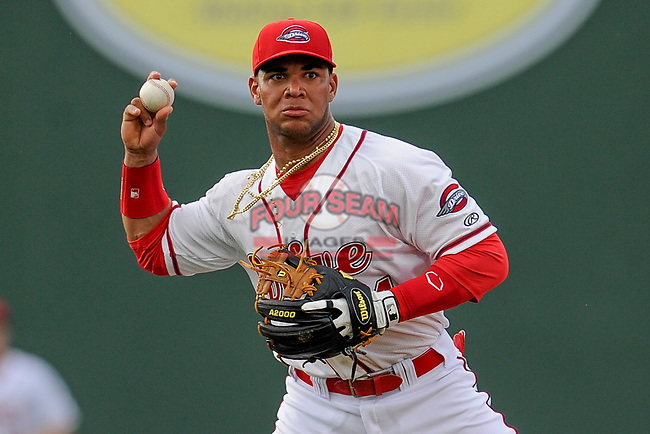 Infielder Yoan Moncada (24) of the Greenville Drive works out before a game against the Lexington Legends on Monday, May 18, 2015, at Fluor Field at the West End in Greenville, South Carolina. Moncada, a 19-year-old prospect from Cuba, is making his professional debut today in the Red Sox organization. (Tom Priddy/Four Seam Images)