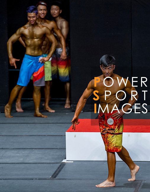 A bodybuilder competes in the South China Men's Sport Physique (Group B) category during the 2016 Hong Kong Bodybuilding Championships on 12 June 2016 at Queen Elizabeth Stadium, Hong Kong, China. Photo by Lucas Schifres / Power Sport Images