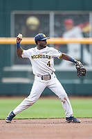 Michigan Wolverines second baseman Ako Thomas (4) makes a throw to first base during Game 11 of the NCAA College World Series against the Texas Tech Red Raiders on June 21, 2019 at TD Ameritrade Park in Omaha, Nebraska. Michigan defeated Texas Tech 15-3 and is headed to the CWS Finals. (Andrew Woolley/Four Seam Images)