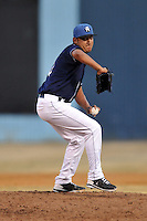 Asheville Tourists pitcher Roberto Padilla #10 delivers a pitch during a game against the West Virginia Power at McCormick Field on April 13, 2013 in Asheville, North Carolina. The Power won the game 14-9. (Tony Farlow/Four Seam Images).