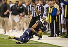 Sept 13, 2014; Wide receiver Will Fuller catches a pass during the Shamrock Series football game against Purdue in Indianapolis. (Photo by Barbara Johnston/University of Notre Dame)