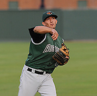 Catcher Myles Schroder (11) of the Augusta GreenJackets, a San Francisco Giants affiliate, prior to a game against the Greenville Drive on August 22, 2012, at Fluor Field at the West End in Greenville, South Carolina. Greenville won game two of a doubleheader, 5-2. (Tom Priddy/Four Seam Images)
