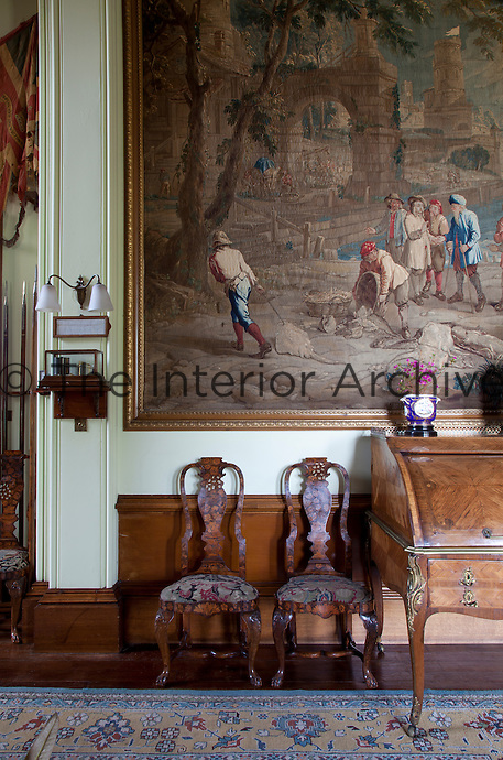 Detail of a pair of antique chairs (possibly Dutch marquetry) in the inner hall