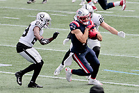 27th September 2020, Foxborough, New England, USA;  New England Patriots wide receiver Julian Edelman (11) turns up field between Las Vegas Raiders safety Lamarcus Joyner (29) and Las Vegas Raiders safety Erik Harris (25) during the game between the New England Patriots and the Las Vegas Raiders