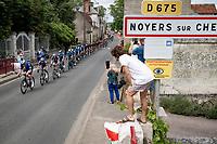 peloton rolling through Noyers sur Cher<br /> <br /> Stage 6 from Tours to Châteauroux (160km)<br /> 108th Tour de France 2021 (2.UWT)<br /> <br /> ©kramon