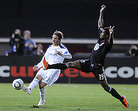 Los Angeles Galaxy midfielder David Beckham (23) makes a pass while cover by DC United midfielder Clyde Simms (19) .    DC United tied  Los Angeles Galaxy 1-1, at RFK Stadium, Saturday April 9, 2011.