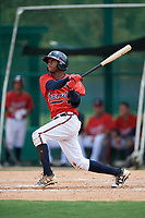 GCL Braves second baseman Luis Ovando (9) hits a single during a game against the GCL Pirates on July 27, 2017 at ESPN Wide World of Sports Complex in Kissimmee, Florida.  GCL Braves defeated the GCL Pirates 8-6.  (Mike Janes/Four Seam Images)
