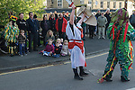 White Bread Meadow annual auction Bourne Lincolnshire UK. Bourne Borderers Morris team perform a Mummers Play performed before the auction. Children sitting on the ground will run in the 200 yard race.