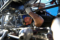 Feb 22, 2020; Chandler, AZ, USA; Blake Holding, crew member for NHRA top fuel driver Leah Pruett (not pictured) works on the engine of her dragster during qualifying for the Arizona Nationals at Wild Horse Pass Motorsports Park. Mandatory Credit: Mark J. Rebilas-USA TODAY Sports