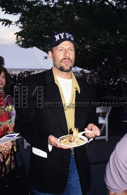 Bruce Willis pictured at celebrating motion pictured and TV productions in New York City Mayor Giuliani honors industry leaders at Crystle Apple Awards on June 14, 1995.