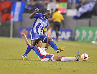 Yeltsin Tejeda (17) of Costa Rica defends the ball against Omar Chavez (2) of Honduras.  Honduras defeated Costa Rica 1-0 at the quaterfinal game of the Concacaf Gold Cup, M&T Stadium, Sunday July 21 , 2013.