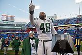 New York Jets Jordan Jenkins (48) jokes with fans during an NFL football game against the Buffalo Bills, Sunday, December 9, 2018, in Orchard Park, N.Y.  (Mike Janes Photography)
