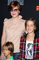 """CENTURY CITY, CA, USA - SEPTEMBER 27: Molly Ringwald, Roman Stylianos Gianopoulos, Mathilda Ereni Gianopolous arrive at the Los Angeles Screening Of Disney XD's """"Star Wars Rebels: Spark Of Rebellion"""" held at the AMC Century City 15 Theatre on September 27, 2014 in Century City, California, United States. (Photo by Celebrity Monitor)"""