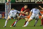 Blue's pair Rhys Williams and Luke Hamilton close the gap on Munster full back Felix Jones..Celtic League.Cardiff Blues v Munster.02.11.12.©Steve Pope