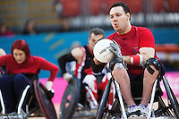 18 APR 2012 - LONDON, GBR - Great Britain's Ross Morrison (GBR) (Class 2.5) (right) prepares to pass during the London International Invitational Wheelchair Rugby Tournament match against Canada at the Olympic Park Basketball Arena in Stratford, London, Great Britain (PHOTO (C) 2012 NIGEL FARROW)