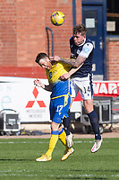 3rd April 2021; Dens Park, Dundee, Scotland; Scottish FA Cup Football, Dundee FC versus St Johnstone; Lee Ashcroft of Dundee heads clear from Guy Melamed of St Johnstone