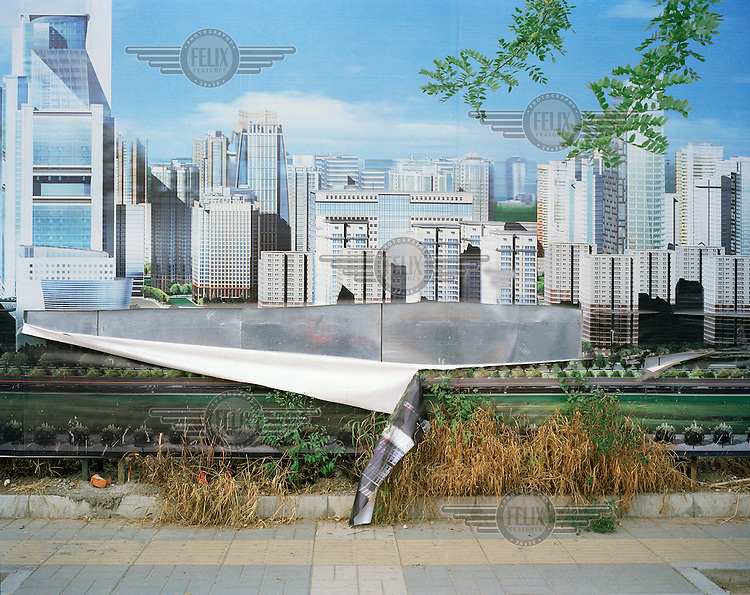 A peeling poster showing the planned skyline of the Central Business District in 2008. Many of the buildings are presently under construction.