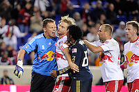 New York Red Bulls goalkeeper Frank Rost (1) argues with Sheanon Williams (25) of the Philadelphia Union as Stephen Keel (22) intercedes. The New York Red Bulls defeated the Philadelphia Union  1-0 during a Major League Soccer (MLS) match at Red Bull Arena in Harrison, NJ, on October 20, 2011.