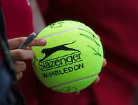24-06-13, England, London,  AELTC, Wimbledon, Tennis, Wimbledon 2013, Day one, Wimbledon large ball with players autographs<br /> <br /> <br /> Photo: Henk Koster