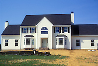 New construction, no landscaping, scalped property before any landscaping, Colonial house, sunny day