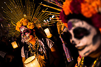 Young women, dressed as La Catrina, a Mexican pop culture icon representing the Death, take part in the Day of the Dead celebrations in Oaxaca, Mexico, 31 October 2019. Day of the Dead (Día de Muertos), a religious holiday combining the death veneration rituals of Pre-Hispanic cultures with the Catholic practice, is widely celebrated throughout all of Mexico. Based on the belief that the souls of the departed may come back to this world on that day, people gather together while either praying or joyfully eating, drinking, and playing music, to remember friends or family members who have died and to support their souls on the spiritual journey.