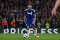 Cesc Fabregas of Chelsea looks for options in front of a Priceless board during the UEFA Champions League match between Chelsea and Maccabi Tel Aviv at Stamford Bridge, London, England on 16 September 2015. Photo by Andy Rowland.