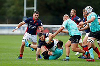 Dan Barnes of London Scottish is tackled with Lewis Wynne looking on during the Championship Cup match between London Scottish Football Club and Nottingham Rugby at Richmond Athletic Ground, Richmond, United Kingdom on 28 September 2019. Photo by Carlton Myrie / PRiME Media Images
