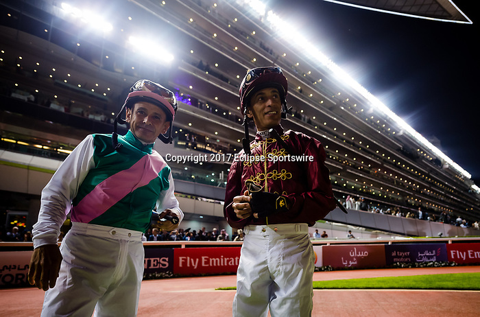 DUBAI, UNITED ARAB EMIRATES - MARCH 25: Mike Smith (pink hat), and John Velazquez in the walking circle prior to the Dubai World Cup at Meydan Racecourse during Dubai World Cup Day on March 25, 2017 in Dubai, United Arab Emirates. (Photo by Douglas DeFelice/Eclipse Sportswire/Getty Images)