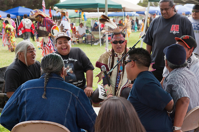 Drum group plays and sings traditional songs for the dancers during the San Luis Rey pow wow, Oceanside California