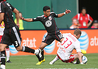 Cristian Castillo #12 of D.C. United reaches in to get the ball from Carl Robinson #33 of the New York Red Bulls during an MLS match on May 1 2010, at RFK Stadium in Washington D.C.