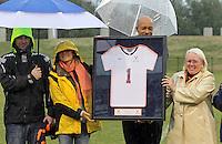 March 06, 2011 - Charlottesville, Virginia, USA -  From right, SHARON DONNELLY, the mother of slain Virginia women's lacrosse player Yeardley Love, stands with University of Virginia Athletic Director Craig Littlepage and her daughter Lexie Love during a ceremony permanently retiring the number one jersey worn by Yeardley Love Sunday at Klockner Stadium. Love's body was found May 3, 2010 and Virginia men's lacrosse player George Huguely is charged with murder. (Credit Image: © Andrew Shurtleff)