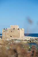 Scenic view of seacoast with old castle ruin against clear sky, Paphos, Cyprus