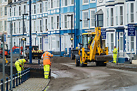 "Pictured: Council workers and diggers clear debris off the promenade of the seaside town of Aberystwyth, Wales, UK. Monday 23 October 2017<br /> Re: A clean operation is under way at coastal parts of the UK were affected by Storm Brian.<br /> Roads in Aberystwyth's seafront and at nearby Aberaeron, Wales were shut on Saturday morning as a yellow ""be aware"" Met Office warning is in place."