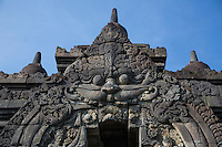 Borobudur, Java, Indonesia.  Kala, God of the Underworld and Symbol of Time.  Kala is a Hindu Javanese-Balinese Deity whose fierce face scares away malevolent spirits, thus serving as a guardian of the temple.  Here he guards the entrance to the upper levels of the stupa.