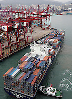 A view of a container ship at the port of Hong Kong, China, 07 April 2009. Asian shipping shares slumped Tuesday, reflecting a decrease in global demand for commodities and an industry suffering from excess capacity due to the global downturn in trade.