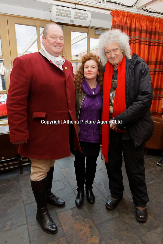 Pictured L-R: Byron John, Grace Powell and Brian May. Thursday 26 December 2019<br /> Re: Guitarist Brian May of Queen has joined the Boxing Day Hunt in Wind Street, Swansea, Wales, UK.