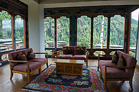 Bhutan, Paro, common sitting area of Zhiwa Ling Hotel.