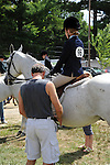 Young girl getting ready for horse show at Cheshire Fair in Swanzey, New Hampshire USA