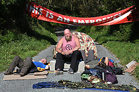Pictured: Climate protesters blocking access on Rhoscrowther Road to the Valero refinery in Pembroke Dock, Wales, UK. Thursday 19 September 2019<br /> Re: Ten Extinction Rebellion climate change protesters have blocked three entrances of the Valero site in Pembroke Dock, Pembrokeshire, one of the biggest oil refineries in Europe.<br /> Protesters have attached themselves to wooden boxes filled with concrete in a bit to stop vehicles from entering or leaving the site.