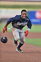 Mississippi Braves second baseman Ozzie Albies (20) runs to third base during a game against the Tennessee Smokies at Smokies Stadium on July 23, 2016 in Kodak, Tennessee. The Braves defeated the Smokies 3-0. (Tony Farlow/Four Seam Images)