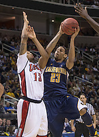 March 21st, 2013: California's ALlen Crabbe shoots over UNLV's Anthony Bennett for the basket during a game at HP Pavilion, San Jose, California. California defeated UNLV 64 - 61