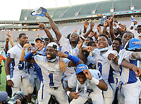 Armwood Hawks, including Garian Brown #1, Gregory Newton #2, Alvin Bailey #3, celebrates their state title after the Florida High School Athletic Association 6A Championship Game at Florida's Citrus Bowl on December 17, 2011 in Orlando, Florida.  Armwood defeated Miami Central 40-31.  (Mike Janes/Four Seam Images)