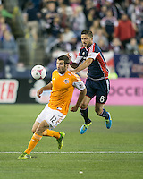 Houston Dynamo forward Will Bruin (12) retrieves a high ball in front of New England Revolution defender Chris Tierney (8).  The New England Revolution played to a 1-1 draw against the Houston Dynamo during a Major League Soccer (MLS) match at Gillette Stadium in Foxborough, MA on September 28, 2013.