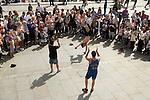 Tourists Trafalgar Square watching street acrobats perform. London Uk 2013 2010s