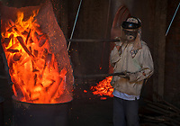 Changing the burned wood from a productive Brick Kiln. The Brick production and Kiln of Vinh Long in the Mekong Delta, Vietnam.