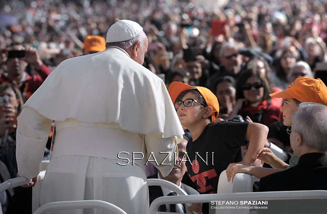 Pope Francis has given a lift to two lucky kids the two boys are  Antonio Di Muro and Raffaele Scafari mounted,  on the Popemobile during his general audience in St. Peter's Square at the Vatican, Wednesday.on October 8, 2014