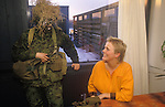 Danish Army female soldier in camouflage with colleague another soldier in their barracks Denmark 1990s
