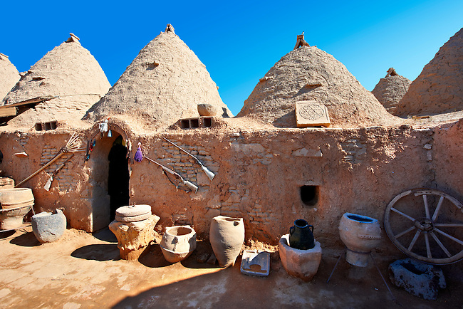 """Pictures of the beehive adobe buildings of Harran, south west Anatolia, Turkey.  Harran was a major ancient city in Upper Mesopotamia whose site is near the modern village of Altınbaşak, Turkey, 24 miles (44 kilometers) southeast of Şanlıurfa. The location is in a district of Şanlıurfa Province that is also named """"Harran"""". Harran is famous for its traditional 'beehive' adobe houses, constructed entirely without wood. The design of these makes them cool inside. 16"""