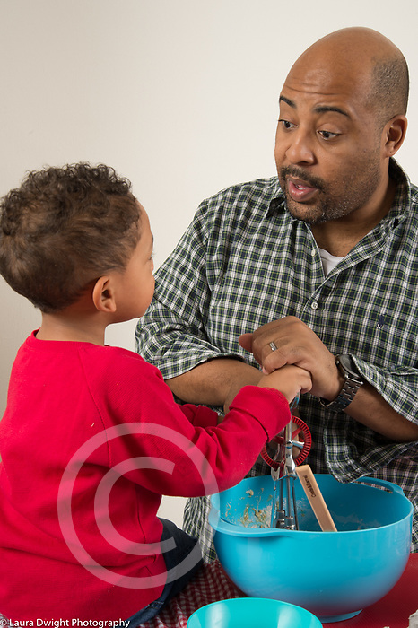 Father doing baking activity with 3 year old son