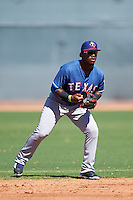 Texas Rangers Yeyson Yrizarri (4) during an Instructional League game against the Kansas City Royals on October 4, 2016 at the Surprise Stadium Complex in Surprise, Arizona.  (Mike Janes/Four Seam Images)